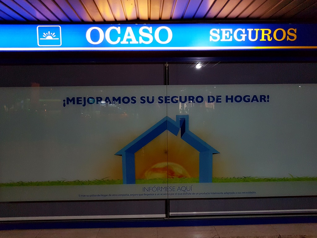Ejemplo de publicidad en escaparates de Ocaso-Seguros-Hogar