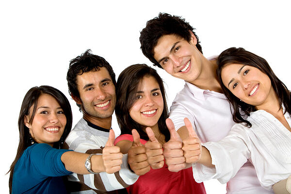 Happy group of friends together with thumbs up isolated on white